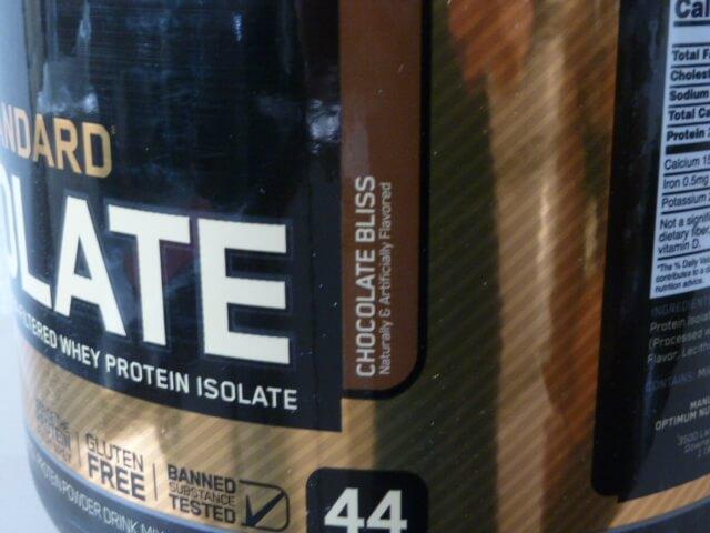 オプチマムのゴールドスタンダードのアイソレートのチョコレートブリス味の粉末